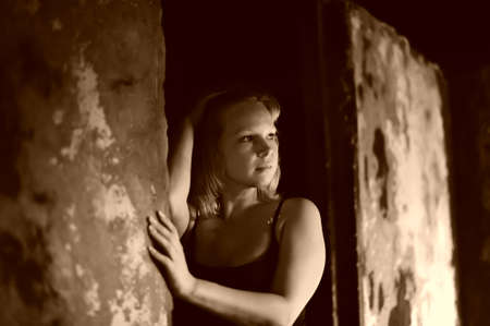 the girl on ruins of the thrown house photo