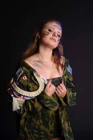The woman with a camouflage make-up photo