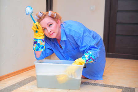 stereotypical:  housewife is engaged in house cleaning