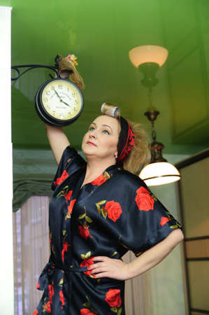 middle-aged housewife, shake the dust off the clock photo
