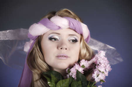 The flower fairy with lilacs Stock Photo - 11936669