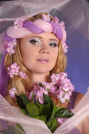 The flower fairy with lilacs Stock Photo - 11936675