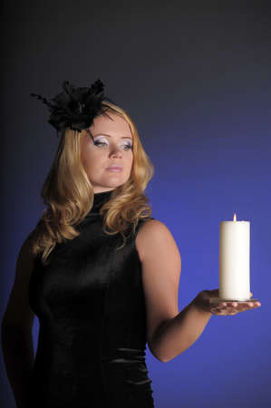 The woman from candles in a hand photo