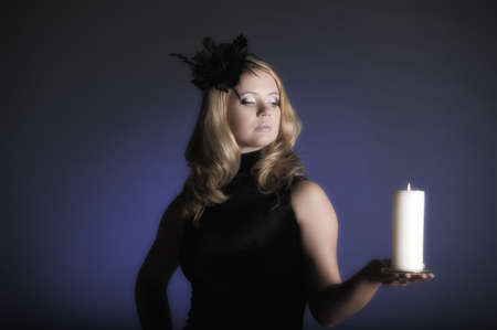 The woman from candles in a hand Stock Photo - 11936665