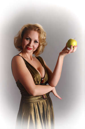blond in retro style with apple Stock Photo - 12234910