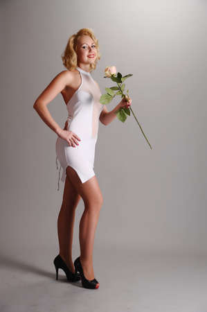 blonde in a white dress with a white rose Stock Photo - 18038882