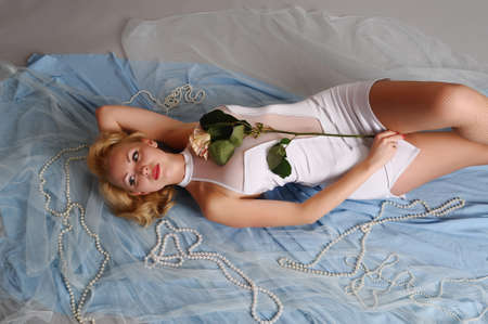 blonde in a white dress with a white rose Stock Photo - 18038961