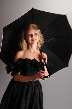 Blonde with a black dress with a parasol  photo