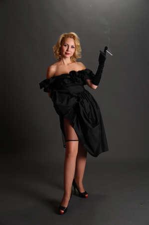elegant woman in a hat smoking Stock Photo
