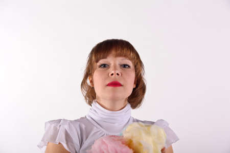 The girl with sweet cotton wool Stock Photo