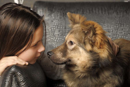 Girl With Her Dog.  photo