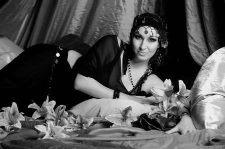 Beautiful Belly Dancer Lying Down, sepia Stock Photo - 11963644