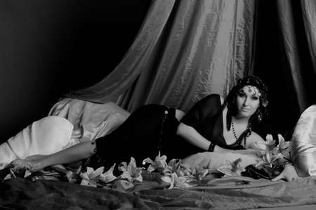 Beautiful Belly Dancer Lying Down, sepia Stock Photo - 11963640
