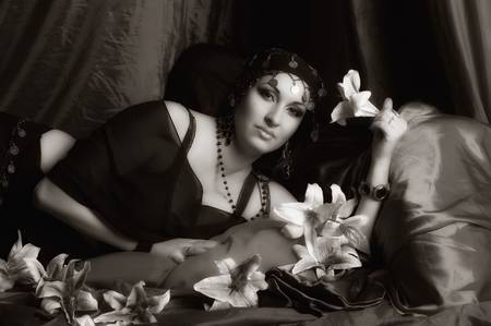 Beautiful Belly Dancer Lying Down, sepia photo
