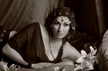 Beautiful Belly Dancer Lying Down, sepia Stock Photo - 11963643