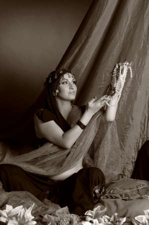 Shot of an oriental woman in a traditional costume,retro photo