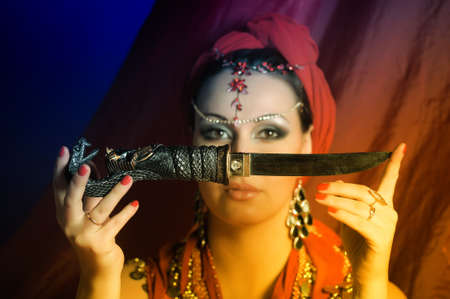 Shot of an oriental woman in a traditional costume.  photo