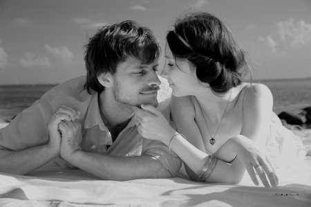 Young romantic couple on the beach, sepia tone Stock Photo - 11960811