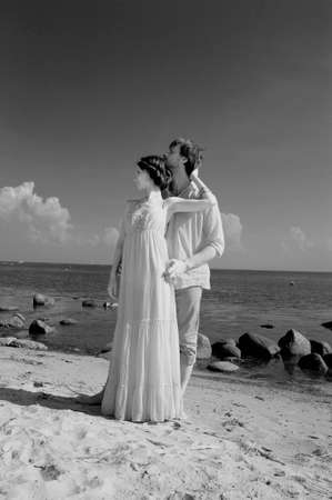 honeymooner: young couple in love on the shore, retro Stock Photo