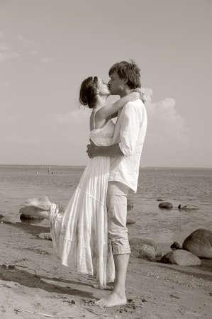 Beautiful couple at the beach , sepia photo