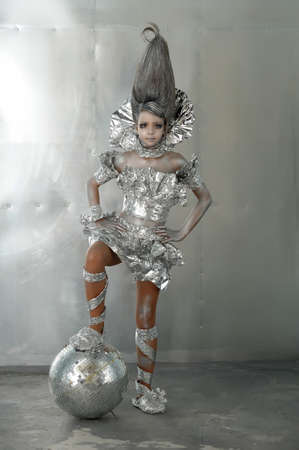 girl in silver and foil