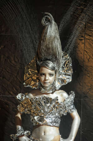 girl in silver and foil  Stock Photo - 12018464