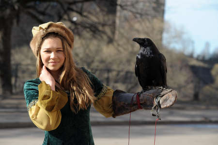 girl in medieval dress with a raven photo