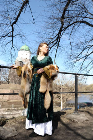 girl in medieval clothes and furs