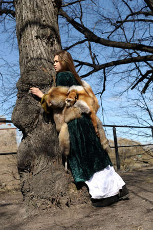 girl in medieval clothes and furs photo