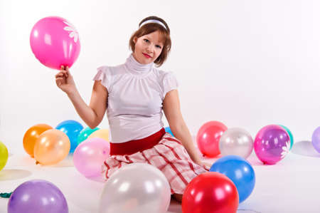girl with balloons in the studio Stock Photo - 12026328