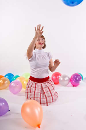 girl with balloons in the studio photo