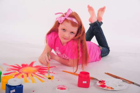 Girl painting on the floor Stock Photo - 12026264