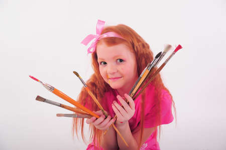 girl with brushes in hand Stock Photo - 12026266