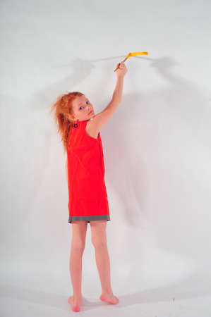 painting and decorating: Girl painting on the wall