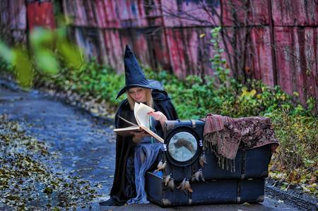 the witch with the book of spells Stock Photo - 13295635