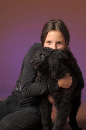 teen girl with black dog photo