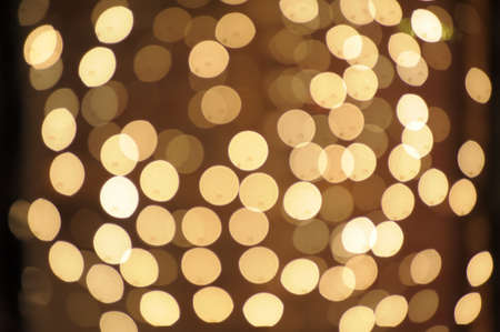 Sunny Yellow  bokeh background made from white lights Stock Photo - 13280945