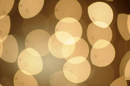 Sunny Yellow  bokeh background made from white lights photo