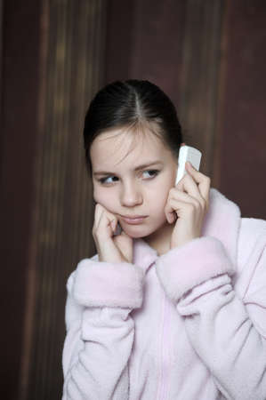 dismay: Teen talking on the phone