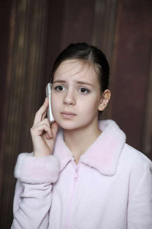 Teen talking on the phone photo