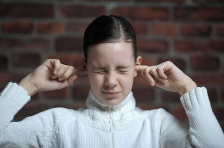 girl  with his hands covering his ears Stock Photo - 12161160