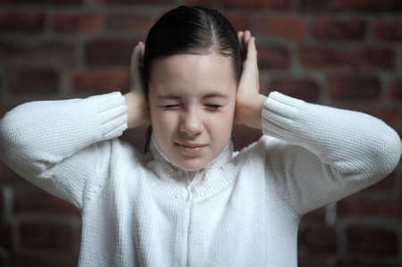 girl  with his hands covering his ears Stock Photo - 12160930