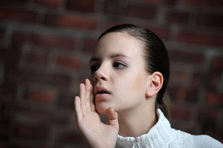 Girl whispering something Stock Photo - 12174949