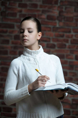 Girl writing in notebook photo