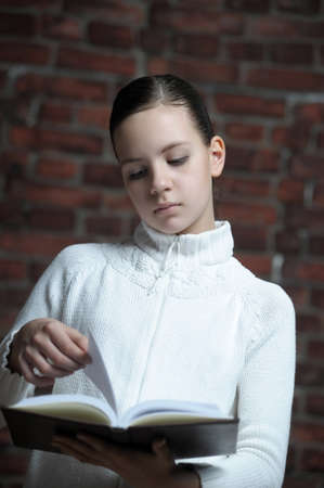 teen girl with a book photo