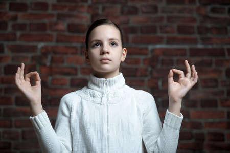 meditates: teen girl meditates Stock Photo