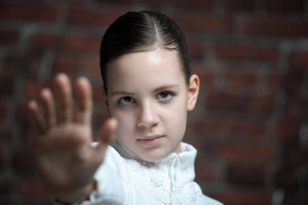 one eyed: Teenage girl making stop gesture  Stock Photo