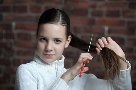 teen girl is going to cut your hair photo
