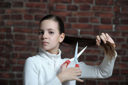 teen girl is going to cut your hair Stock Photo - 12161186