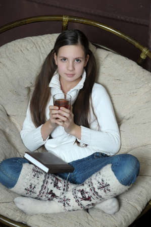 teen girl in a chair with tea